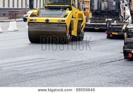 Asphalt Paving Works With Road Rollers