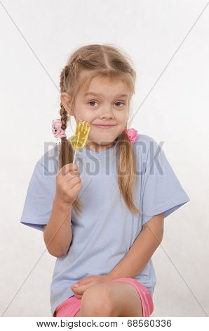 Portrait Of Five Year Girl With Lollipop In Her Hand