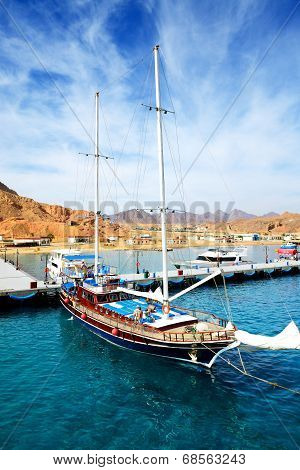 Sharm El Sheikh, Egypt -  December 4: The Sail Yacht With Tourists Is Near Pier In Harbor Of Sharm E