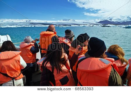 Jokusarlon, Iceland, July 7th 2014. - Tourists wearing life vests ride on amphibian vehicle on glacial lake in southeastern part of Iceland.