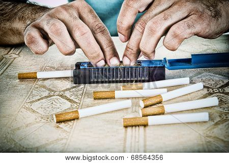 Hands Of Man Making Cigarettes