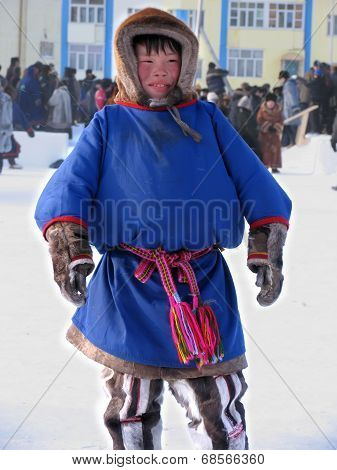 Nadym, Russia - March 11, 2005: Unfamiliar Teen Nenets, Stands In The Center Of The Square.