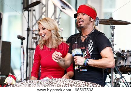 NEW YORK-JUL 18: Bret Michaels (R) and Elisabeth Hasselbeck at Fox and Friends' All-American Summer Concert Series on the corner of 48th Street and 6th Avenue on July 18, 2014 in New York City.