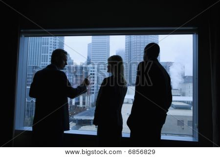 Businesspeople Looking Out The Window