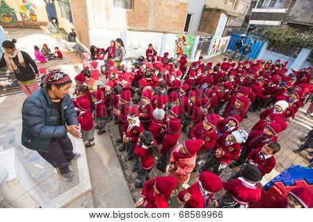 KATHMANDU, NEPAL - DEC 22, 2013: Unknown pupils during dance lesson in primary school. Only only 25% of girls attend schools and half of the children can reach the 5 grade.