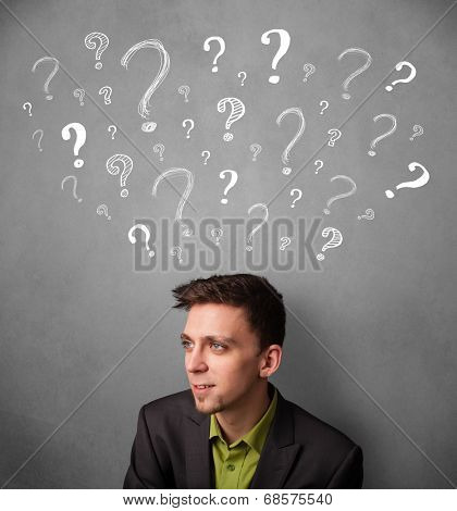 Young businessman thinking with sketched question marks all over his head