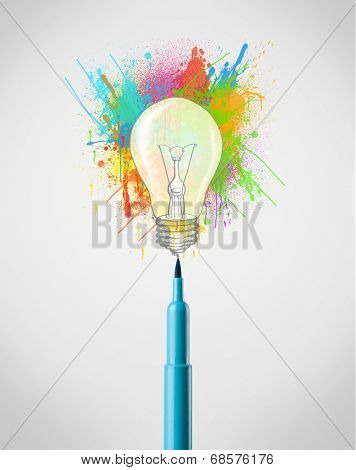 Colored felt pen close-up with colored paint splashes and lightbulb concept