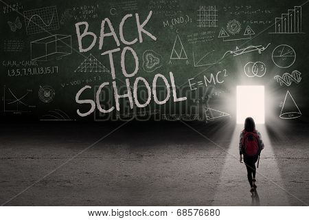 Female Student Leading To The Door School