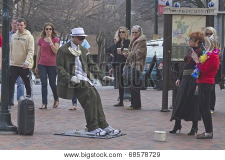 Living Statue Of Man Blown By The Wind
