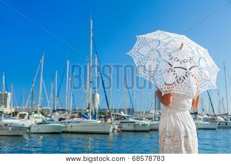 Girl On The Pier With A Lace Umbrella Looking At The Yacht