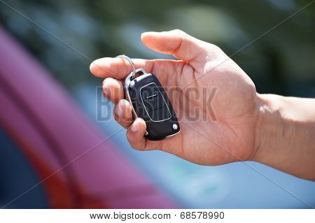 Man Holding Car Key Outdoors