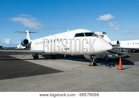 The Plane At The Airport Ready For Boarding