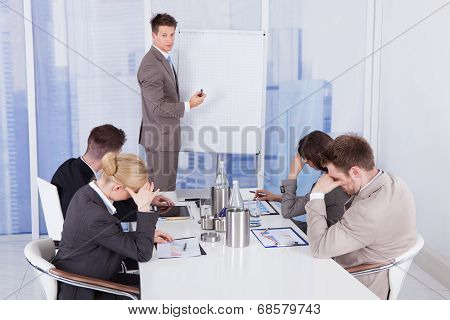 Colleagues Getting Bored During Business Presentation