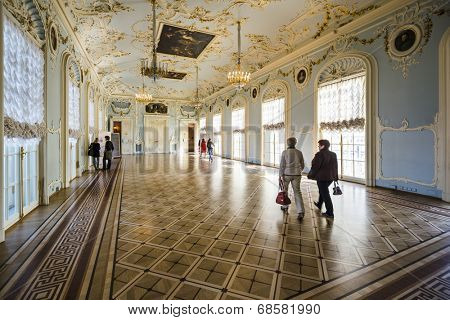 SAINT PETERSBURG, RUSSIA - SEPTEMBER 8, 2013: Visitors tour the Hermitage Museum. Founded in 1764, it is one of the oldest museums in the world.