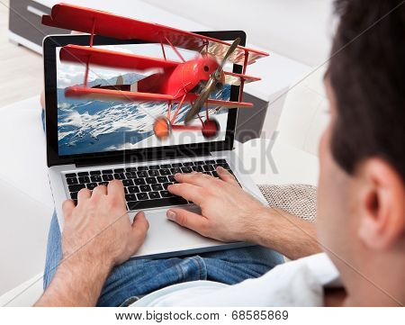 Close-up Of Man Using Laptop