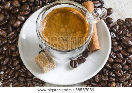 Crema On Fresh Espresso With Sugar, Cinnamon And Coffee Beans