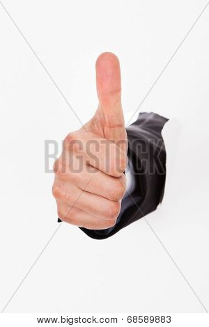 Hand Gesturing Thumbs Up Through White Wall