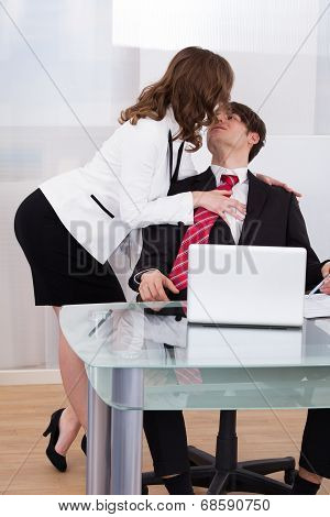 Sensuous Secretary Seducing Businessman At Desk