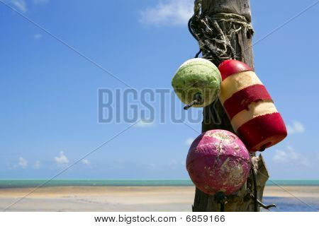 Florida Keys sea view with old fender colorful buoy aged