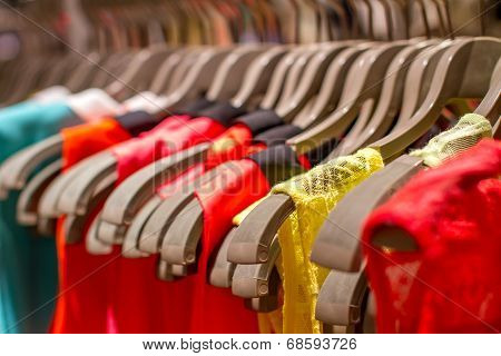 T-shirts Hanging On A Hanger In The Store
