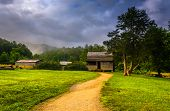 stock photo of cade  - The John Oliver Cabin on a foggy morning at Cade - JPG