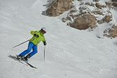 image of suny  - jumping skier at mountain winter snow fresh suny day - JPG