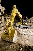 picture of boom-truck  - digger with mechanical arm on the ruins of a house at night in wide angle shot - JPG
