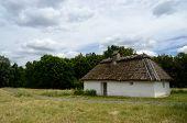 stock photo of farmworker  - Antique white clay house with hay roof in Pirogovo open air museum - JPG