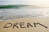 stock photo of sunny beach  - dream word written on the sand of the beach  - JPG