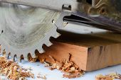 image of sawing  - close up of circular saw and saw dust - JPG