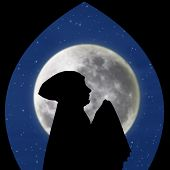 image of muslimah  - Silhouette of muslimah praying under blue moon - JPG
