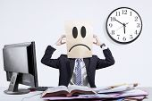 picture of scratching head  - Stressful anonymous businessman scratching his head in office - JPG