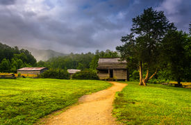 stock photo of cade  - The John Oliver Cabin on a foggy morning at Cade