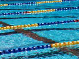 pic of swim meet  - Swimming pool lanes at swim meet outdoors - JPG