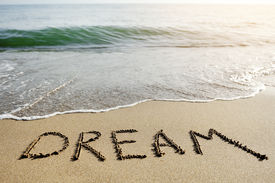 pic of think positive  - dream word written on the sand of the beach  - JPG