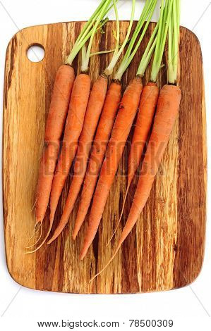 Close-up image of  carrots placed on cutting board