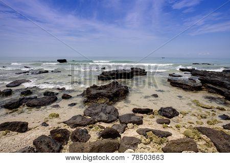 Tropical seascape - rocks , sea and blue sky