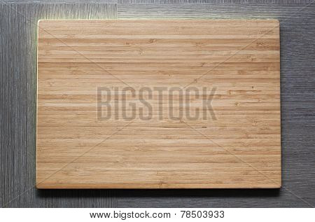 New wooden plate with empty textspace.