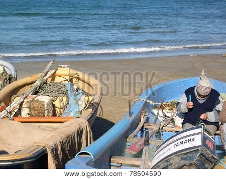 Fishermen With Small Fishing Boat And Nets