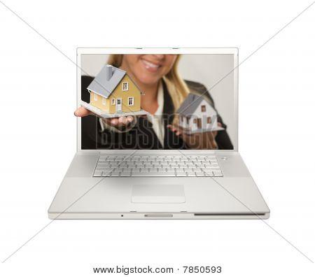 Woman Handing House Through Laptop Screen