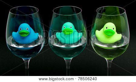 Blue And Green Rubber Ducks In Wineglasses
