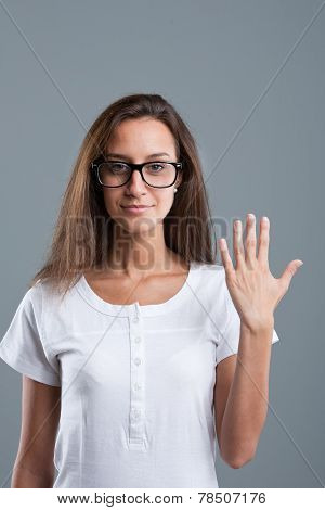 Beautiful Girl Showing Number Five With Fingers Of One Hand