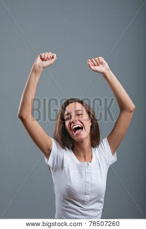 Nice Woman Exulting And Laughing Rising Arms Up