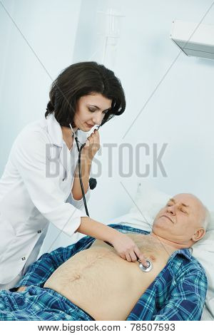 doctor listening heartbeat of patient by phonendoscope in clinic hospital