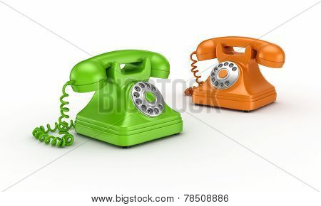 Colorful vintage telephones.