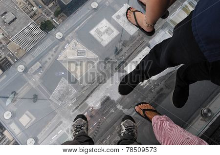 Feet on the glass balcony at the skydeck