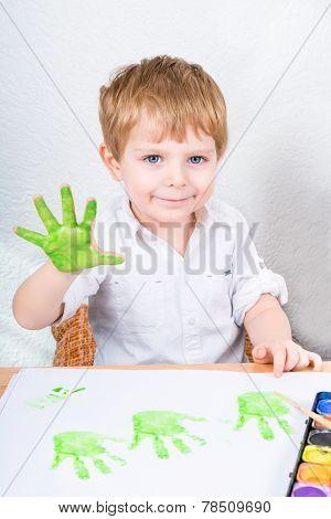 Active Kid Boy Having Fun With Making Handpaints