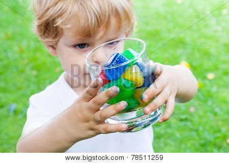 Beautiful Toddler Boy With Glass Of Berry Ice Cubes