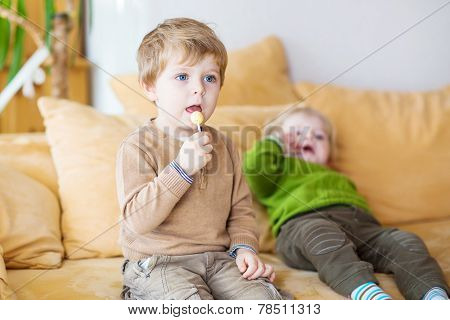Two Little Brother Boys Watching Tv Indoor