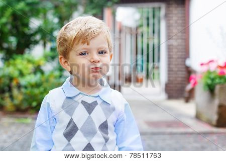 Funny Happy And Smiling Kid Boy On Way To Nursery